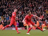 Liverpool's English midfielder Jordan Henderson celebrates after scoring the opening goal of during the English Premier League football match between Liverpool and Manchester City at the Anfield stadium in Liverpool, north west England, on March 1, 2015
