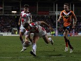 Tommy Makinson of St Helens goes over for a try during the First Utility Super League match between St Helens and Castleford Tigers at Langtree Park on February 27, 2015