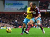 Winston Reid of West Ham United battles with Glenn Murray of Crystal Palace during the Barclays Premier League match between West Ham United and Crystal Palace at Boleyn Ground on February 28, 2015