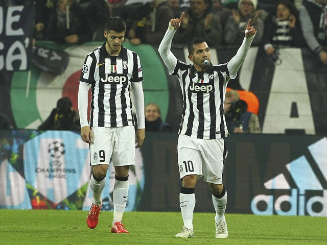 Carlos Tevez of Juventus FC celebrates after scoring the opening goal during the UEFA Champions League Round of 16 match between Juventus and Borussia Dortmund at Juventus Arena on February 24, 2015