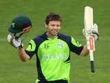 Ed Joyce of Ireland celebrates making his century during the 2015 ICC Cricket World Cup match between Zimbabwe and Ireland at Bellerive Oval on March 7, 2015