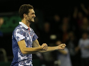 Great Britain's James Ward celebrates after winning his Davis Cup World Group first-round singles tennis match 6-7 (4/7), 5-7, 6-3, 7-6 (7/3), 15-13, against John Isner of US at The Emirates Arena in Glasgow, Scotland, on March 6, 2015