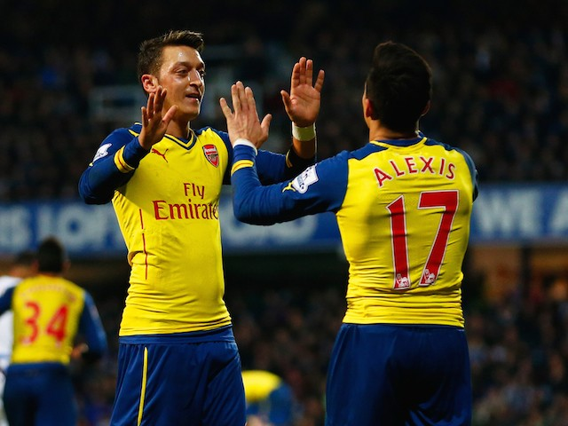Alexis Sanchez of Arsenal (17) celebrates with Mesut Ozil as he scores their second goal during the Barclays Premier League match on  March 4, 2015
