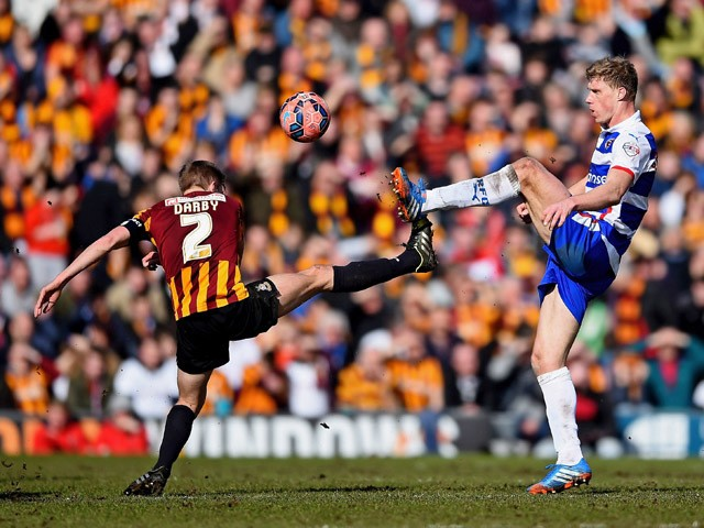 Stephen Darby of Bradford City and Pavel Pogrebnyak of Reading compete for the ball during the FA Cup Quarter Final match between Bradford City and Reading at the Coral Windows Stadium, Valley Parade on March 7, 2015