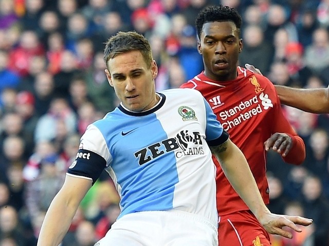 Blackburn's English defender Matthew Kilgallon (L) clears the ball during FA Cup quarter-final match between Liverpool and Blackburn Rovers at Anfield in Liverpool, north west England on March 8, 2015