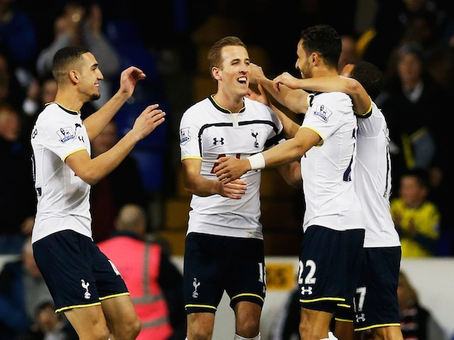 Nacer Chadli of Spurs (22) celebrates with team mates as he scores their first goal during the Barclays Premier League match against Swansea City on March 4, 2015