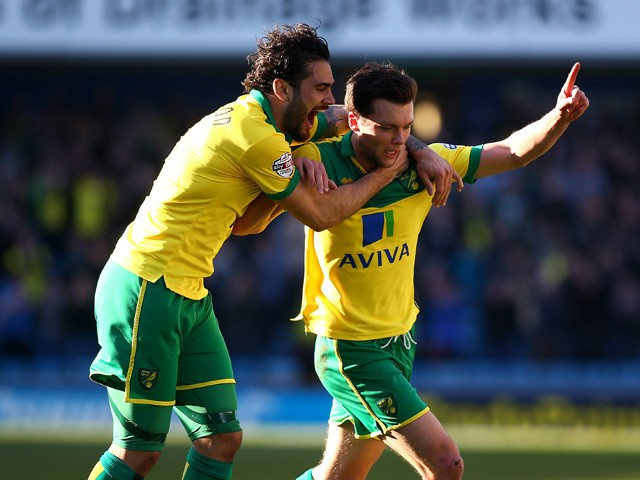 Jonathan Howson of Norwich celebrates with team mate Bradley Johnson after he scores the first goal of the game during the Sky Bet Championship match between Millwall and Norwich City at The Den on March 07, 2015