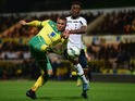 Carlton Morris of Norwich City battles with Christian Maghoma of Spurs during the Barclays U21 Premier League match between Norwich City U21 and Tottenham Hotspur U21 at Carrow Road on October 14, 2014
