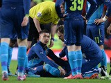 Arsenal's English midfielder Alex Oxlade-Chamberlain receives treatment after picking up an injury during the FA Cup quarter-final football match between Manchester United and Arsenal at Old Trafford in Manchester, north west England, on March 9, 2015