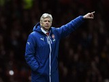 Arsene Wenger the manager of Arsenal directs his players during the FA Cup Quarter Final match between Manchester United and Arsenal at Old Trafford on March 9, 2015