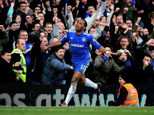 Didier Drogba of Chelsea celebrates after scoring his team's fourth goal during the Barclays Premier League match between Chelsea and West Ham United at Stamford Bridge on March 13, 2010