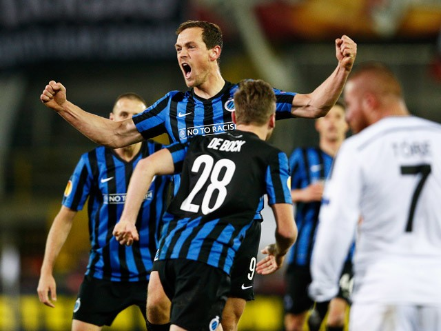 Tom De Sutter #9 of Club Brugge celebrates scoring his teams first goal of the game with team mates during the UEFA Europa League Round of 16 1st leg match between Club Brugge KV and Besiktas JK held at the Jan Breydel Stadium on March 12, 2015
