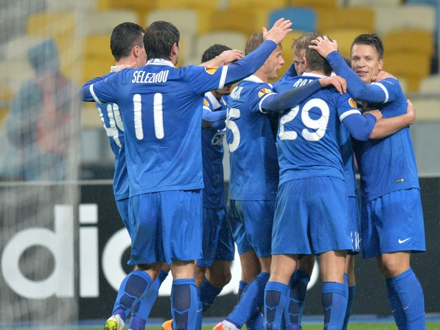 FC Dnipro Dnipropetrovsk players react after scoring a goal against AFC Ajax during their Europa League Round of 16 match in Kiev on March 12, 2015