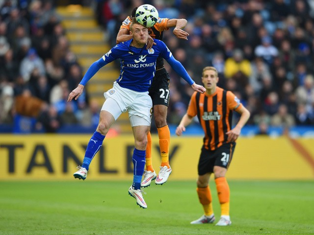 Ahmed Elmohamady of Hull City climbs above Jamie Vardy of Leicester City to head the ball during the Barclays Premier League match between Leicester City and Hull City at The King Power Stadium on March 14, 2015