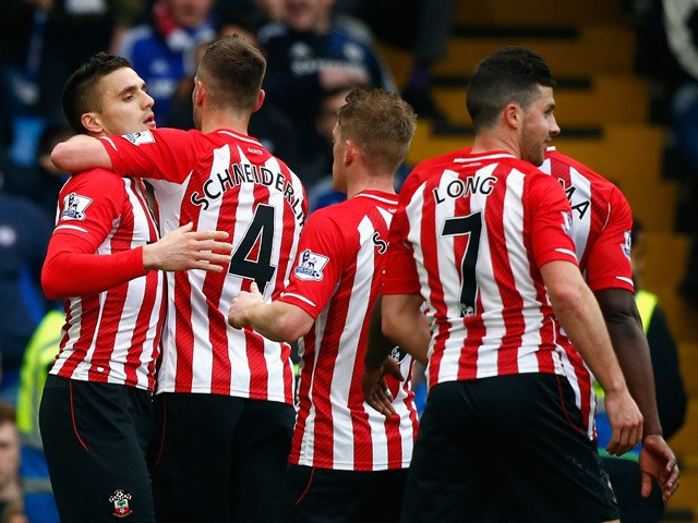 Dusan Tadic of Southampton celebrates scoring their first goal with Morgan Schneiderlin and team mates during the Barclays Premier League match between Chelsea and Southampton at Stamford Bridge on March 15, 2015