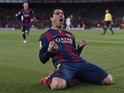 Barcelona's Uruguayan forward Luis Suarez celebrates his goal during the 'clasico' Spanish league football match FC Barcelona vs Real Madrid CF at the Camp Nou stadium in Barcelona on March 22, 2015