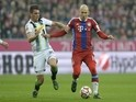 Moenchengladbach's Swiss midfielder Granit Xhaka (L) and Bayern Munich's Dutch midfielder Arjen Robben vie for the ball during the German first division Bundesliga football match on March 22, 2015
