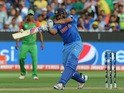 India's batman Rohit Sharma plays a shot off the Bangladesh bowling during the 2015 Cricket World Cup quarter-final match between India and Bangladesh at the Melbourne Cricket Ground (MCG) on March 19, 2015