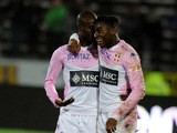 Evian's French forward Clarck NSikulu celebrates with Evian's Senegalese forward Modou Sogou after scoring a goal during the French L1 football match between Evian and Montpellier on march 21, 2015