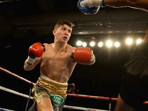 Luke Campbell (L) in action against Levis Morales during their Lightweight contest at The Hull Arena on March 7, 2015 in Hull, England