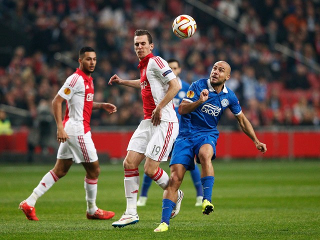 Arkadiusz Milik of Ajax and Dzhaba Kankava of Dnipro compete for the ball during the UEFA Europa League Round of 16, second leg match between AFC Ajax v FC Dnipro Dnipropetrovsk at Amsterdam Arena on March 19, 2015