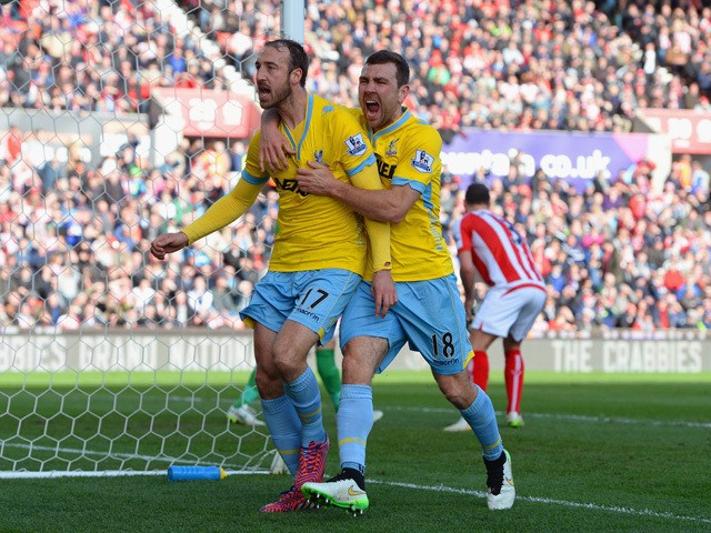 Glenn Murray of Crystal Palace celebrates scoring their first goal from the penalty spor with James McArthur of Crystal Palace during the Barclays Premier League match between Stoke City and Crystal Palace at Britannia Stadium on March 21, 2015