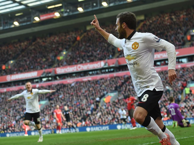 Manchester United's Spanish midfielder Juan Mata celebrates after scoring the opening goal of the English Premier League football match between Liverpool and Manchester United at Anfield in Liverpool, north west England on March 22, 2015