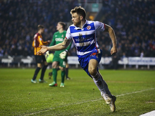Jamie Mackie of Reading celebrates scoring his team's third goal during the FA Cup Quarter Final Replay match between Reading and Bradford City at Madejski Stadium on March 16, 2015