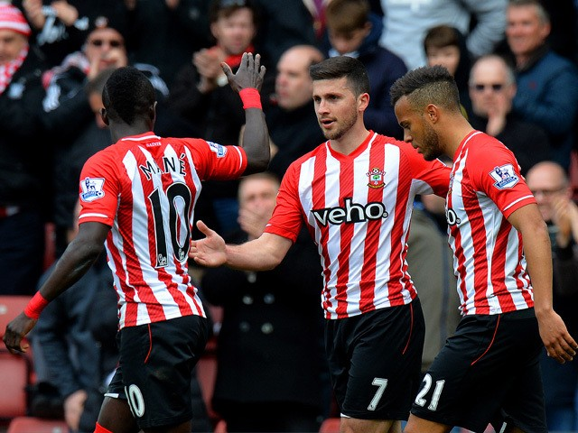 Shane Long of Southampton celebrates with team-mates after scoring the opening goal during the Barclays Premier League match between Southampton and Burnley at St Mary's Stadium on March 21, 2015