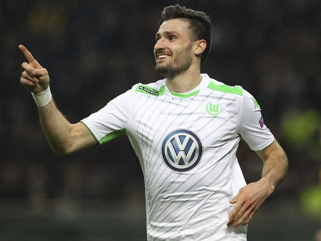 Daniel Caligiuri of VfL Wolfsburg celebrates after scoring the opening goal during the UEFA Europa League Round of 16 match between FC Internazionale Milano and VfL Wolfsburg at Stadio Giuseppe Meazza on March 19, 2015
