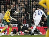 England's striker Wayne Rooney scores his team's first goal during a Euro 2016 Group E qualifying football match between England and Lithuania at Wembley Stadium in north London on March 27, 2015