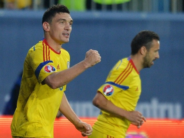 Claudiu Keseru (L) of Romania celebrates after he scored 1-0 against Faroe Islands during the UEFA Euro 2016 qualifying football match during the Group F Euro 2016 qualifying football match between Romania and Faroe Islands, on March 29, 2015