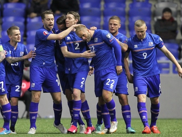 Iceland's players celebrate after scoring a goal during the Euro 2016 qualifying football match between Kazakhstan and Iceland in Astana on March 28, 2015