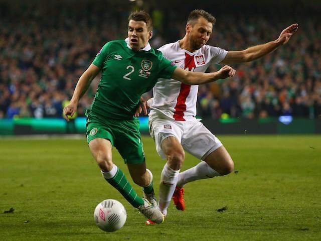 Jakub Wawrzyniak of Poland tackles Seamus Coleman of Republic of Ireland during the EURO 2016 Qualifier match between Republic of Ireland and Poland at Aviva Stadium on March 29, 2015