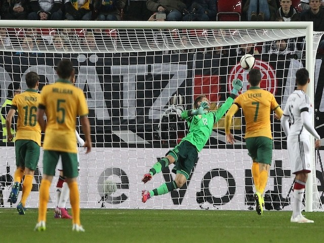 Germany's goalkeeper Ron-Robert Zieler fails to save the ball during the friendly football match Germany vs Australia in Kaiserslautern, southern Germany on March 25, 2015