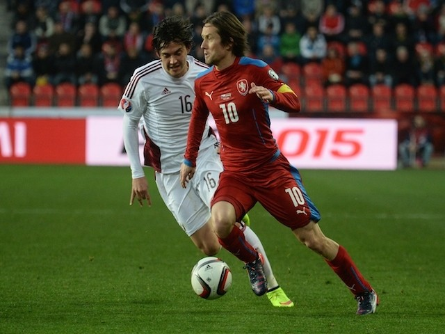 Tomas Rosicky of Czech Republic (R) and Igors Tarasovs of Latvia vie for the ball during the Group A Euro 2016 qualifying football match between Czech Republic and Latvia, on March 28, 2015