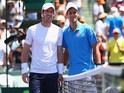 Andy Murray of Great Britain and Novak Djokovic of Serbia pose for a photograph prior to the mens final during the Miami Open Presented by Itau at Crandon Park Tennis Center on April 5, 2015