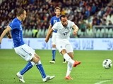 England's midfielder Andros Townsend (R) shoots to score a goal during the friendly football match Italy vs England at the Juventus Stadium in Turin on March 31, 2015