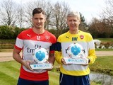Proud pair Olivier Giroud and Arsene Wenger pose with their awards