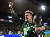 Maximiliano Urruti #37 of Portland Timbers celebrates with teammate Dairon Asprilla #11 of Portland Timbers after scoring a goal during the second half of the game against the FC Dallas at Providence Park on April 4, 2015