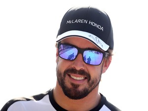 Fernando Alonso of Spain and McLaren Honda smiles as he walks through the paddock after practice for the Malaysia Formula One Grand Prix at Sepang Circuit on March 27, 2015