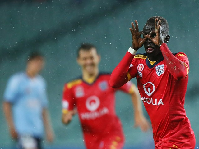 Awer Mabil #17 of Adelaide United celebrates his goal with team-mates during the round 24 A-League match between Sydney FC and Adelaide United at Allianz Stadium on April 4, 2015