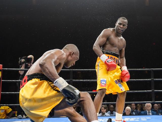 Adonis Stevenson knocks down Sakio Bika during the light heavyweight world championship main event bout at Pepsi Coliseum on April 4, 2015