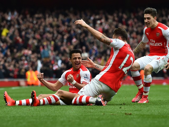 Arsenal's Chilean striker Alexis Sanchez celebrates with teammates after scoring their third goal during the English Premier League football match between Arsenal and Liverpool at the Emirates Stadium in London on April 4, 2015