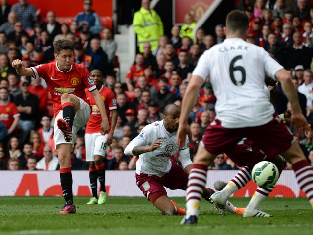 Manchester United's Spanish midfielder Ander Herrera scores the opening goal during the English Premier League football match between Manchester United and Aston Villa at Old Trafford in Manchester, North West England on April 4, 2015