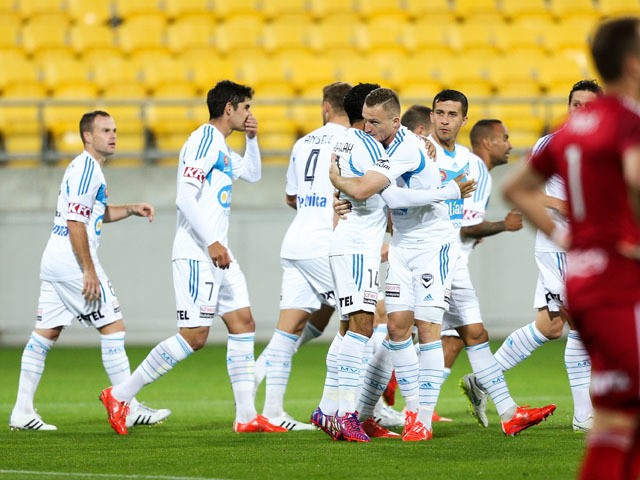 Besart Berisha and Fahid Ben Khalfallah of the Victory celebrate the goal of Gui Finkler during the round 24 A-League match between the Wellington Phoenix and Melbourne City FC at Westpac Stadium on April 5, 2015