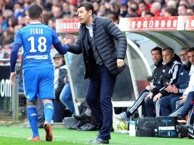 Lyon's French midfielder Nabil Fekir (L) is congratulated by head coach Hubert Fournier after scoring a goal during the French L1 football match against Guingamp on April 4, 2015