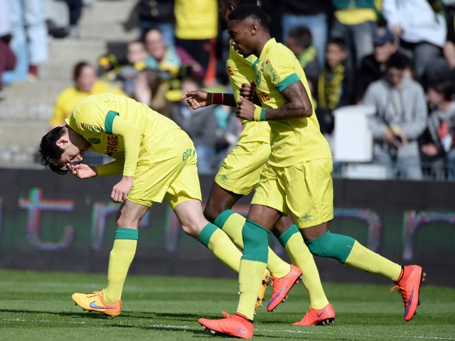 Nantes' US midfielder Alejandro Bedoya celebrates with teammates after scoring a goal during the French L1 football match between Nantes and Caen on April 5, 2015