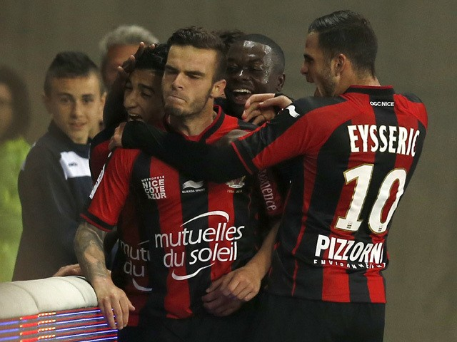 Nice's French forward Alexy Bosetti celebrates with teammates after scoring a goal during the French L1 football match between Nice and Evian Thonon on April 4, 2015