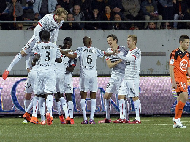 Rennes' players celebrate after scoring during the French L1 football match between FC Lorient and Stade Rennais FC on April 4, 2015